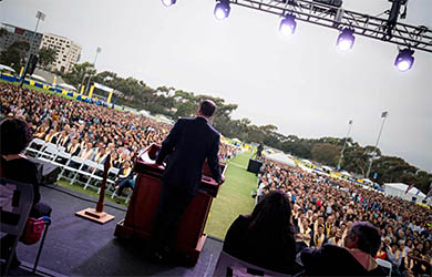 UC San Diego students sit beyond the stage watching the speaker at Convocation 2018