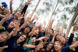 UC San Diego orientation leaders in a group, laughing and cheering