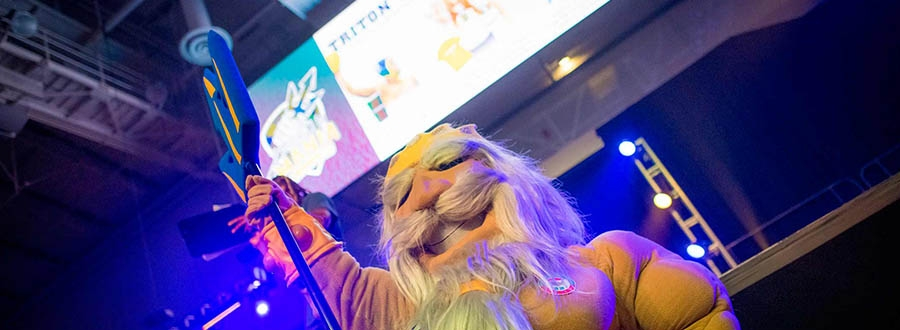 King Triton under bright colorful lights - UC San Diego's mascot